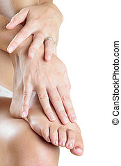 Foot Massage - Womans hands and foot over white