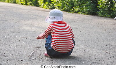 little girl seat - Little girl playing on the road in the...