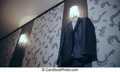men business suit hanging on a hanger