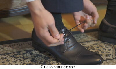 man shoes laces - Man, male, boy, closeup tying the laces on...