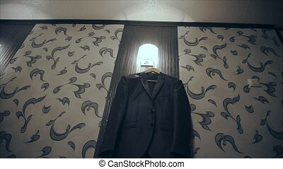 men business suit - Costume hanging on a hanger in the room...