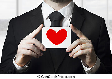businessman holding sign red heart symbol - businessman in...