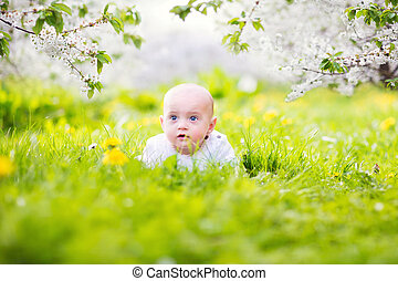 Baby on grass with dandelions - Adorable little happy...
