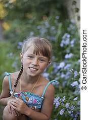 Cheerful little cute girl in the park.