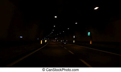 Car driving through tunnel - Car driving highway and through...