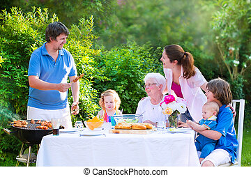 Big family grilling meat for lunch - Happy big family -...