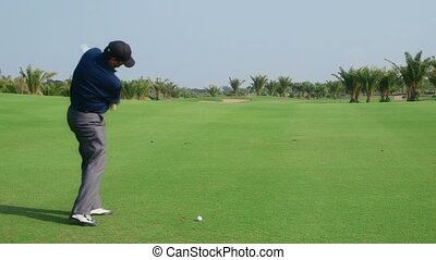Man as professional golfer playing