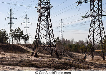 System of electricity pylons and power lines out-of-town,