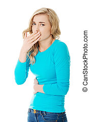 Sick woman about to throw up holding her stomach