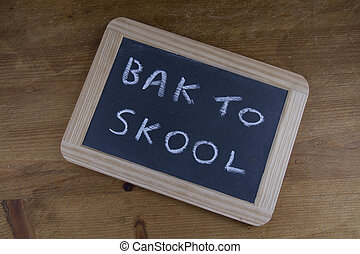 Bak to skool, back to school written on replica old...