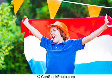 Dutch football fan, little boy cheering - Happy Dutch boy,...