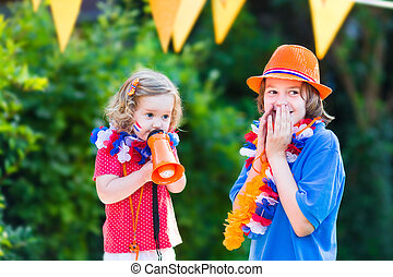 Two kids Dutch football supporters - Two Dutch children,...