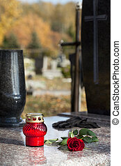 Tombstone with candle - Red candle and rose on the grave...