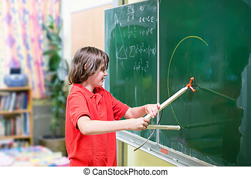 School child at math class - Happy smiling student boy...