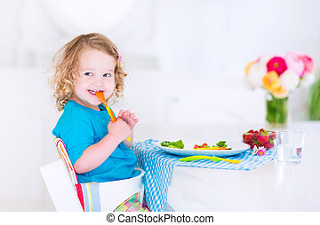 Little girl eating salad for lunch - Happy little girl, cute...