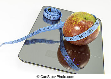 Apples on the scale. Symbolic image for weight loss