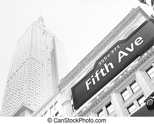 Streets of NYC. - Fifth Avenue street sign against an Empire...