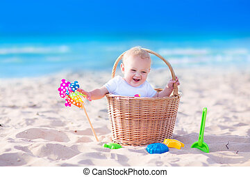 Baby in a basket on the beach - Happy funny baby, adorable...