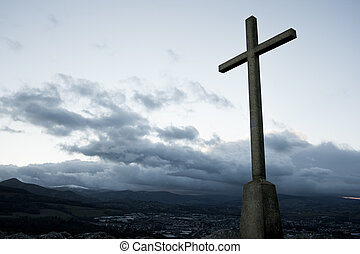 Cross against the sky - Christian cross silhouette on the...