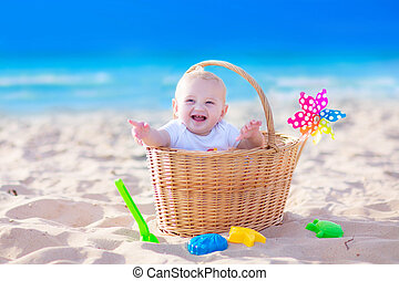 Baby boy on a beach - Happy funny baby, adorable blond...