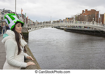 Young woman with St Patricks hat - Girl at River liffey...