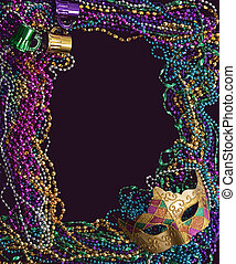 Mardi Gras Mask and Beads - A group of mardi gras beads and...