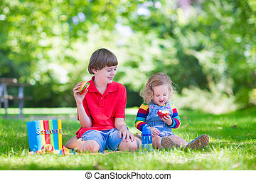 Two kids in a school yard - Two laughing kids happy being...