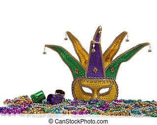 Mardi Gras Mask and Beads - A group of mardi gras beads an...