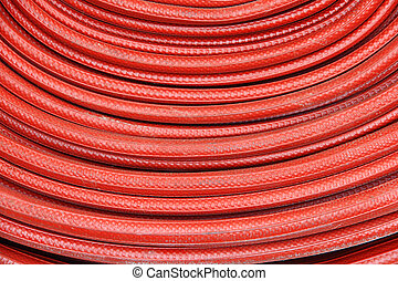 Red fire hose winder through use of firefighters