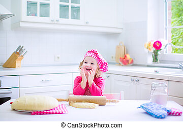 Cute little girl baking a pie - Adorable little child, funny...