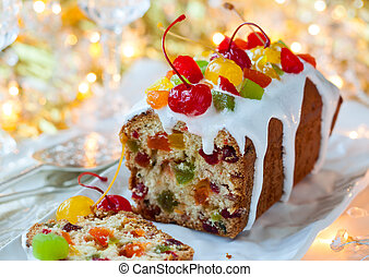 Christmas fruitcake with sugar icing and candied fruits