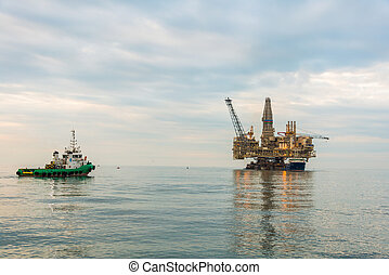 Oil rig platform in the calm sea