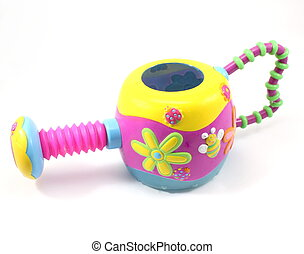 Childs toy sprinkler with flowers on a white background.