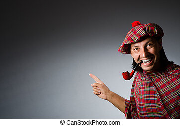 Funny scotsman with smoking pipe