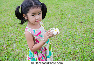 Portrait asian baby girl with flower in her hand