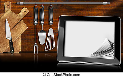 Tablet Computer in the Kitchen - Black tablet computer with...