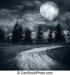 Magic landscape with empty rural road going to pine tree...