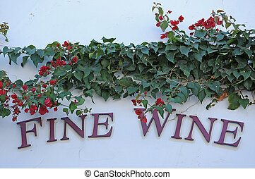 fine wine sign with a floral swag