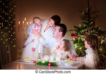 Happy family at Christmas dinner - Big happy young family...