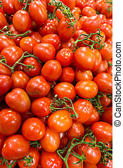 Market stall with lots of tomatoes