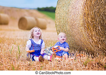 Kids during Oktoberfest - Two children, funyn curly toddler...
