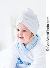 Litlte girl in a bathrobe and towel - Cute curly little girl...