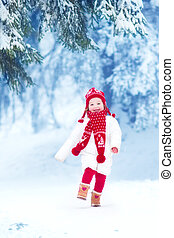 Little girl playing in a winter park - Happy laughing...