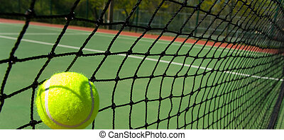 Tennis balls on Court - Bright greenish, yellow tennis ball...