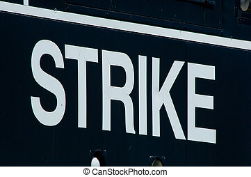 The word STRIKE on a scoreboard at athletic event