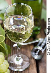 White Wine with fresh Grapes on wooden background
