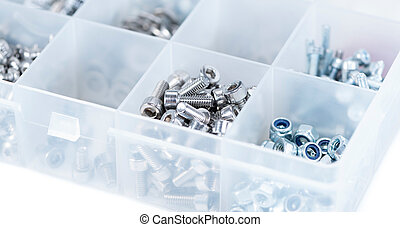 Different Parts sorted in a box - Different Screws and other...