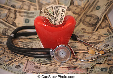 cardiac costs - stethoscope and red heart on a background on...