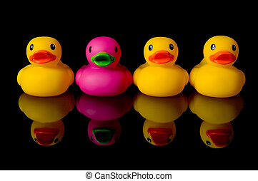 Dare to be different - rubber ducks on black