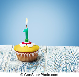 Cupcake with number one on a blue background